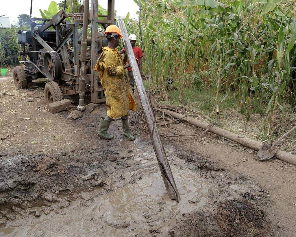 Lamara Project Workers Digging Well